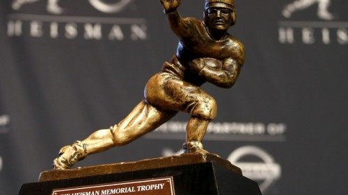The Heisman Trophy is displayed prior to the announcement of the winner, Saturday, Dec. 13, 2014, in New York. The trophy will be awarded to one of the three finalists who are Wisconsin running back Melvin Gordon, Alabama receiver Amari Cooper and Oregon quarterback Marcus Mariota. (AP Photo/Julio Cortez)