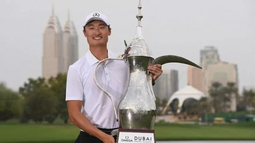 Haotong Li of China celebrates victory after the final round of the Omega Dubai Desert Classic