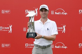KUALA LUMPUR, MALAYSIA - NOVEMBER 01:  Justin Thomas of the United States poses with the CIMB Classic Trophy after he won it by 26 under 262 during round four of the CIMB Classic at Kuala Lumpur Golf & Country Club on November 1, 2015 in Kuala Lumpur, Malaysia.  (Photo by Stanley Chou/Getty Images)