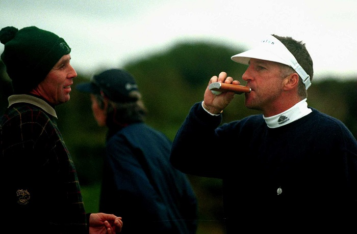 10 Oct 2000: Former England cricketer Ian Botham drinks from his hip flask as former tennis player Ivan Lendl of Czech/USA looks on during a practice round before the Pro-Am of the Alfred Dunhill Cup played on the Old Course at St Andrews, Scotland. Mandatory Credit: Warren Little/ALLSPORT