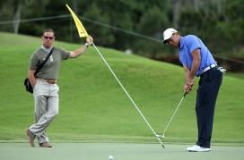 Tiger Woods cùng HLV Sean Foley