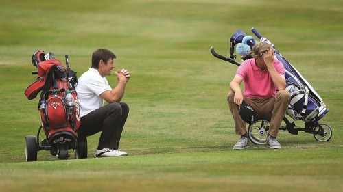 CHESTER, ENGLAND - AUGUST 13:  Phillip Edwards of Nottinghamshire Golf Lessons and David Griffiths take a rest during slow play during day two of the Golfbreaks.com PGA Fourball Championship Final at De Vere Carden Park Hotel on August 13, 2015 in Chester, England.  (Photo by Jan Kruger/Getty Images)