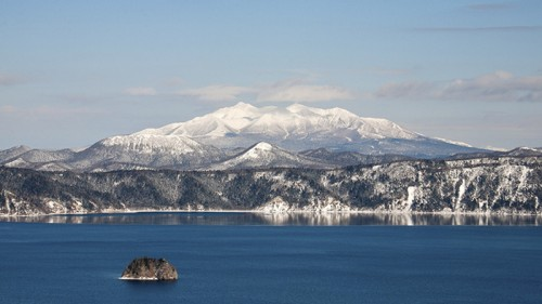 View of the mountains overlooking crater lake, Lake Mashu, Hokkaido, Japan.