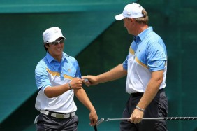Ryo Ishikawa and Ernie Els at 2011 Presidents Cup 2 Photo credit Getty Images